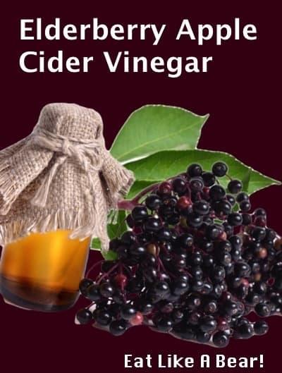 Elderberry apple cider vinegar in a jar with fresh elderberries