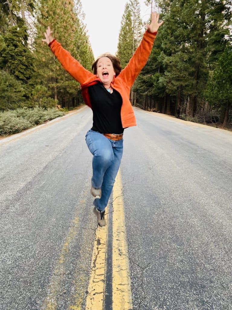 Amanda Rose jumping on a mountain road