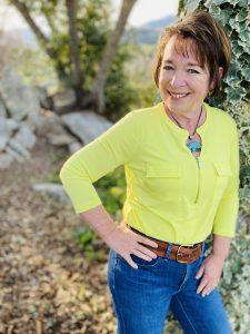 Amanda Rose, Ph.D. outside, hand on hip, smiling