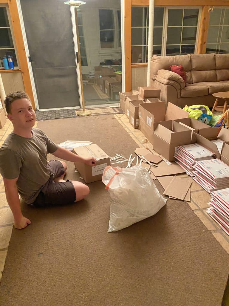 Frederick sitting on the floor packing books