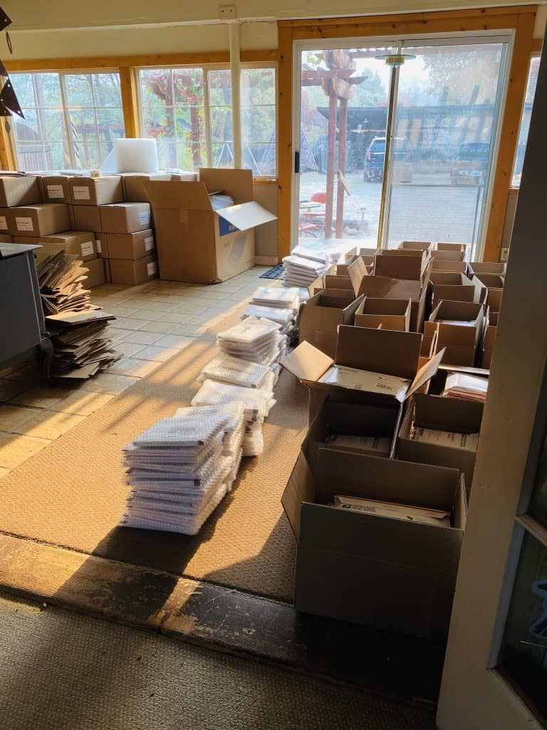 Boxes of books and packing materials lined up.