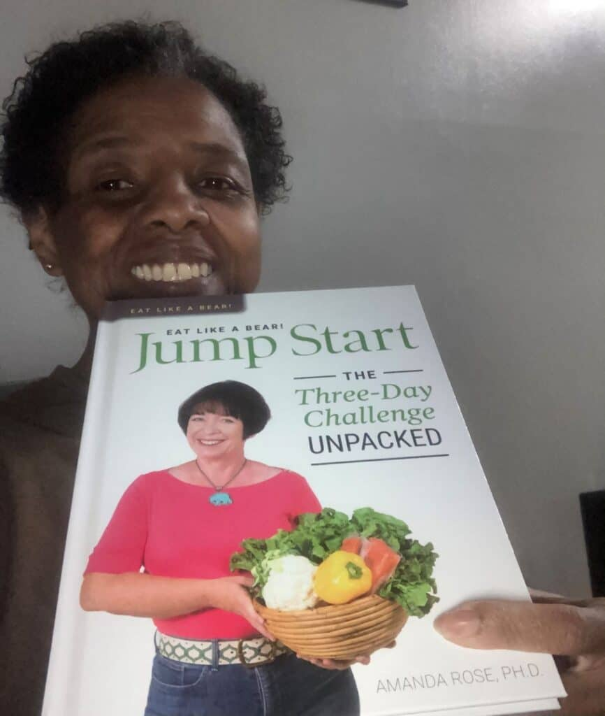 Photo of Terane after 100 pound weight loss with Eat Like a Bear Jump Start book